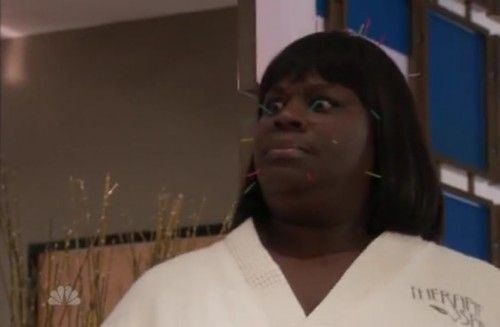 Donna from Parks and Recreation stares at a character as her face is full of acupuncture dry needles.